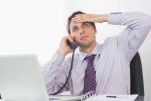 Worried businessman on call at desk